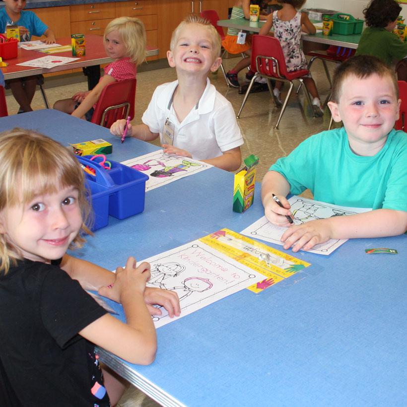 Kindergarten students working in classroom