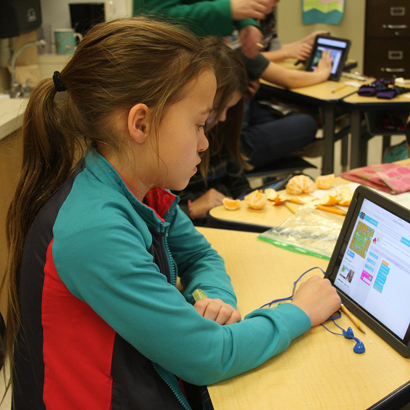 Student working on the Hour of Code