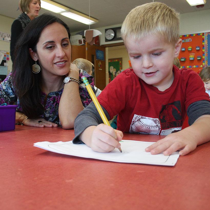 Literacy Coach Krista Senatore working with student on writing