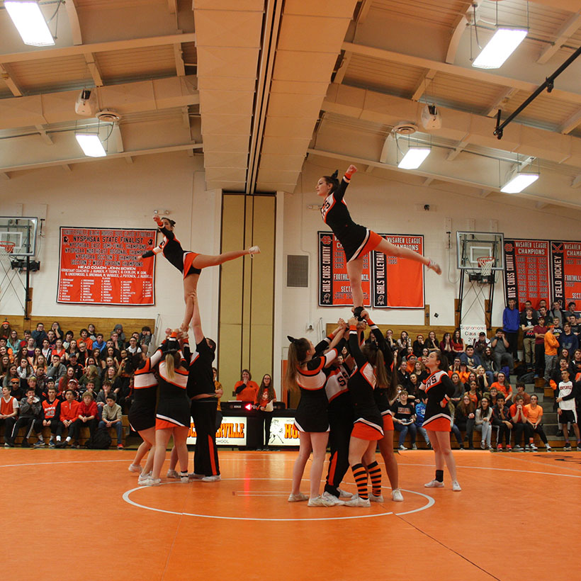 Cheerleaders perform at winter pep rally