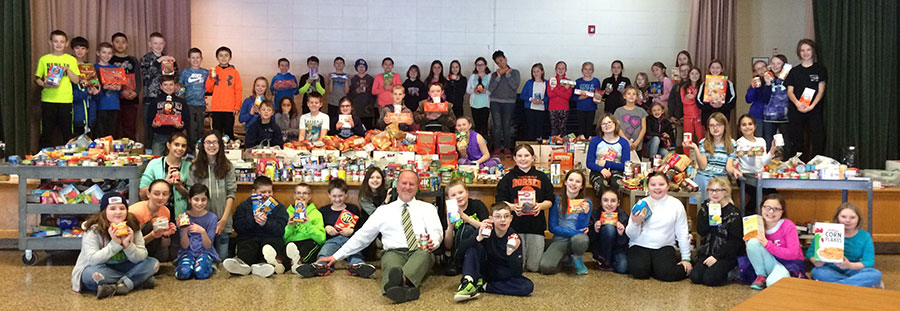 KC Club members pose with donations and Mr. B