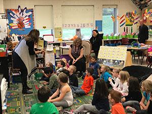 Senior Deputy Commissioner Jhone Ebert observes the push-in ELL program in Mrs. Cogan-Carpenter's first grade classroom.