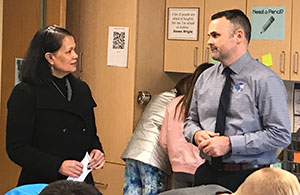 Senior Deputy Commissioner Jhone Ebert discusses the district's 1:1 iPad initiative with sixth grade teacher Jason Mehan.