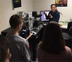 Students learning about the confocal laser scanning microscope from Lily Sun