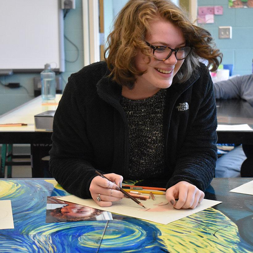 Student in art class