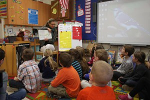 Carol Quick reading to first-graders