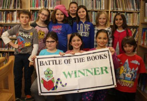 Students with Battle of the Books banner