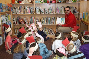 Target employee reading to students