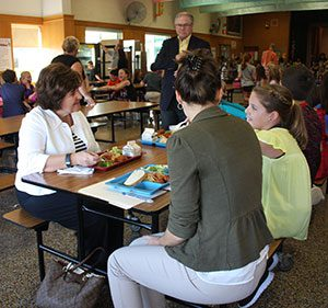 State Senator Kathy Marchione eats lunch with Schuylerville Elementary School students on Tuesday, Oct. 18.