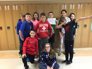 Students in Mr. Mehan's class posing with IXL certificate