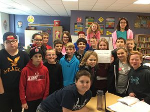 Students in Mrs. Poutre's class posing with IXL certificate