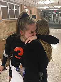 Drohobycky hugging her mom after the varsity volleyball team won on senior night