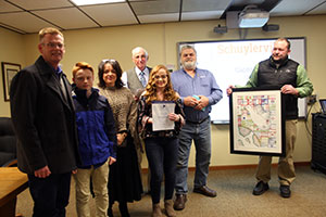 Reagan Hutchinson poses with her piece at Board meeting