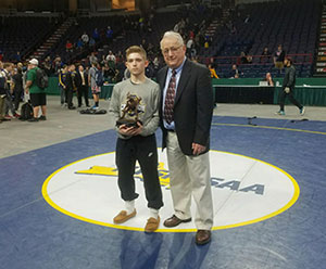 Orion Anderson being presented with 'Most Outstanding Wrestler' Award