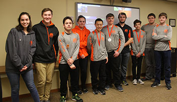 Robotics club poses for a photo at Board of Education meeting on March 20.
