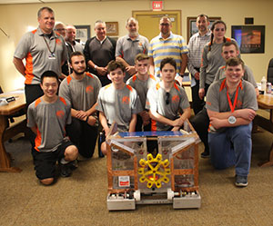 Members of the robotics club pose with the Board of Education