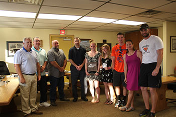 Schuylerville Board members with Amy Moreau, Morgan Gunter, Ian Luhmann, Coach Erin Lloyd and Coach Marcus LaBombard