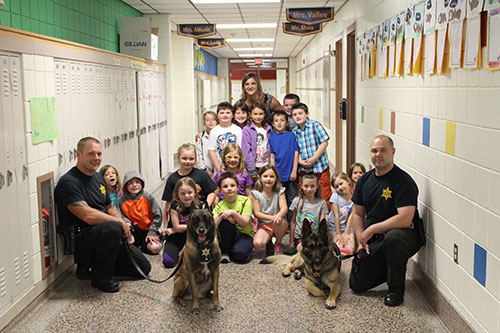 Mrs. Vallee's class poses with K9 Unit and Officers