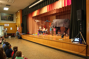Teachers and students perform skit to encourage summer reading