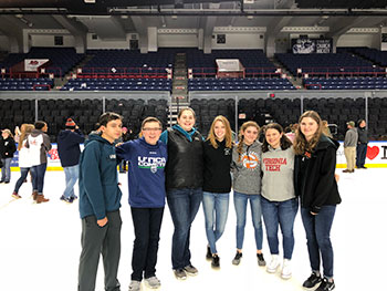 Schuylerville FFA members pose for a photo after the Syracuse Crunch game