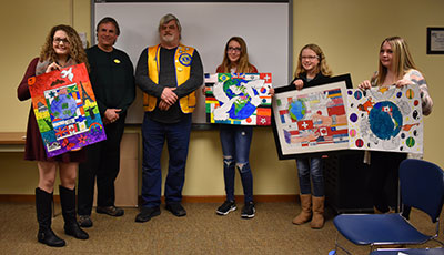 Students pose with Lions club members