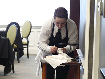 Senior Hannah Diehl competes in the Restaurant Service competition. Courtesy: WSWHE BOCES