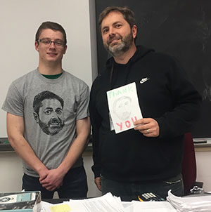 Derek Willson and James Burleigh pose with the thank you card Willson created
