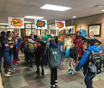 NHS students greet elementary school students