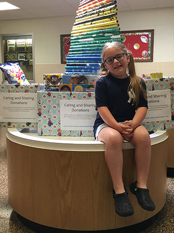 Kiera Ippoliti poses with all of the donations