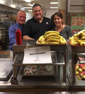Principal Gregg Barthlemas and Food Service Director Sarah Keen serving ice cream