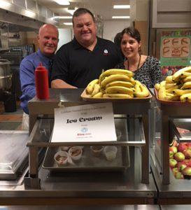 Principal Gregg Barthlemas and Food Service Director Sarah Keen serving ice cream