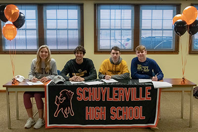 Four students sign letters of intent