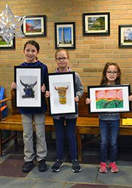 Students posing with their artwork