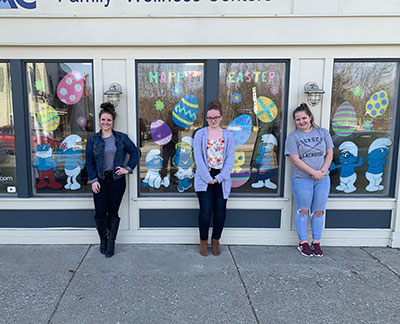 Art club students with Easter mural