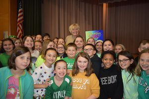 Kindness and Compassion Club students present Mrs. Greene with a plaque