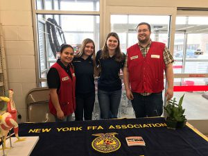Schuylerville FFA Members Audrey Sickles and Lainey Koval with Greenwich #1575 Tractor Supply Store Manager Wayne Foote and Assistant Manager Kate Buckley during National FFA Week and TSC's Paper Emblem Days.