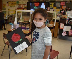 First graders make poppy flowers in honor of veterans