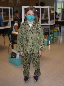 A student dresses in her favorite branch of the military in honor of her mother.