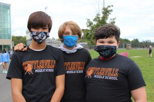 students wearing a middle school tshirt
